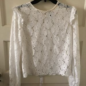 White lace style top with tie in the back.NWOT. M
